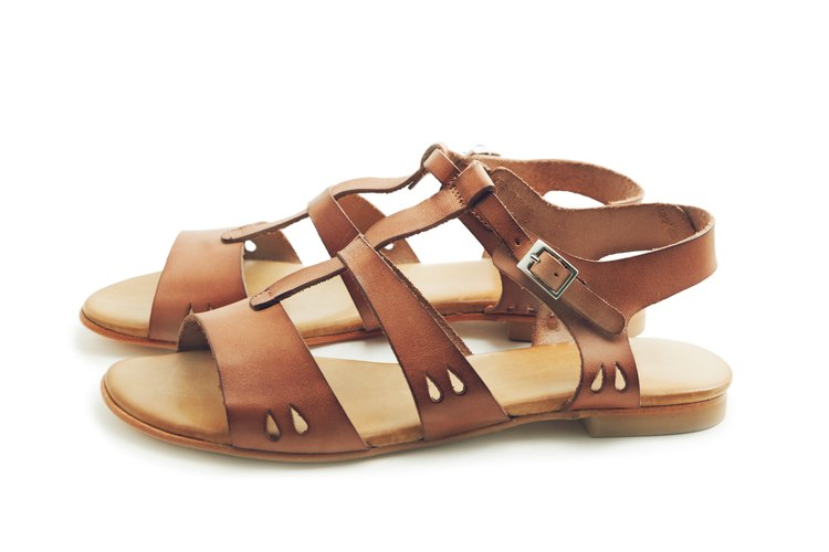 Alaïa Studded Leather Sandals - Shoes - AL232327   The