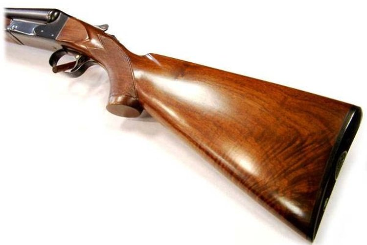 Use a diluted 3:1 solution of Murphy's oil soap and water to clean gun stocks.