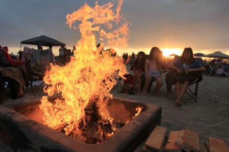Beach bonfires can be a romantic change of pace.