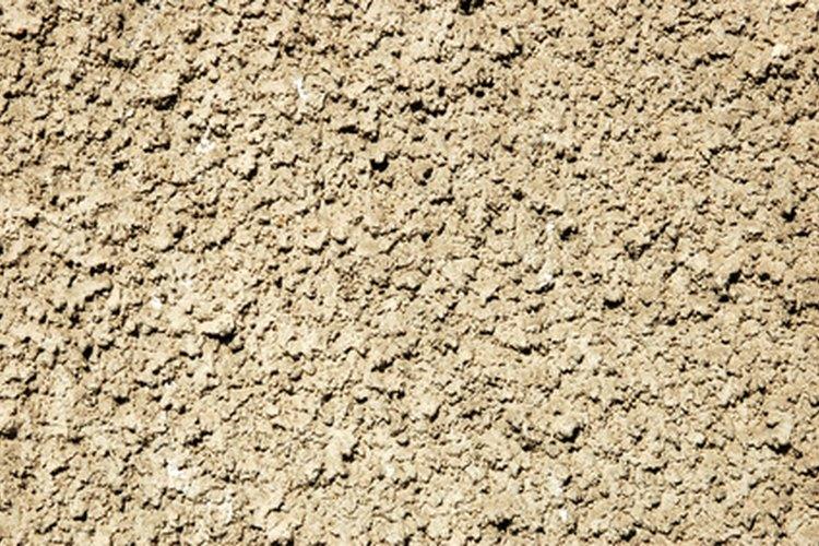 Fabrica tu propia mezcladora de concreto con un barril de plástico.