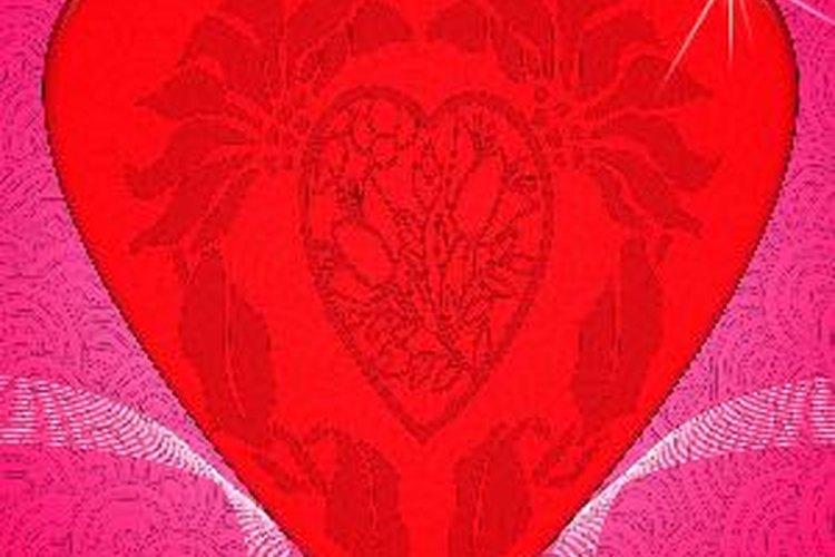 Recorta corazones rojos para los niños.