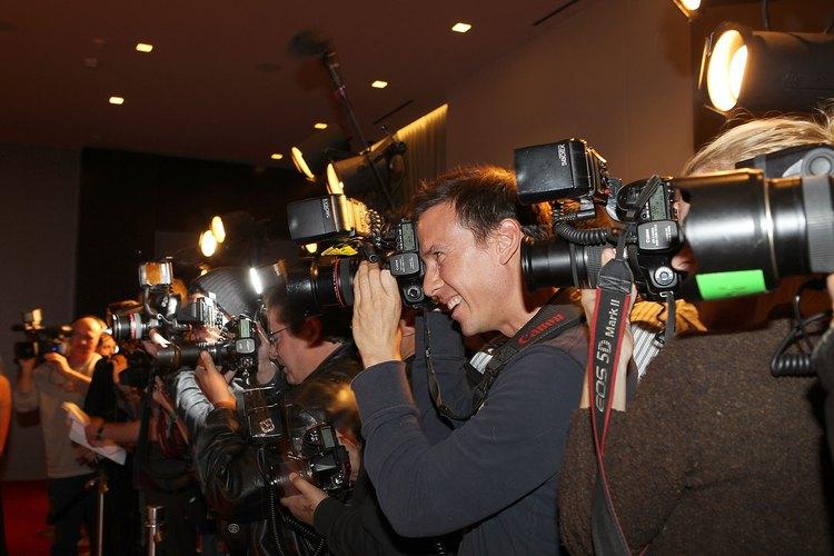Camarógrafos tomando fotografías.