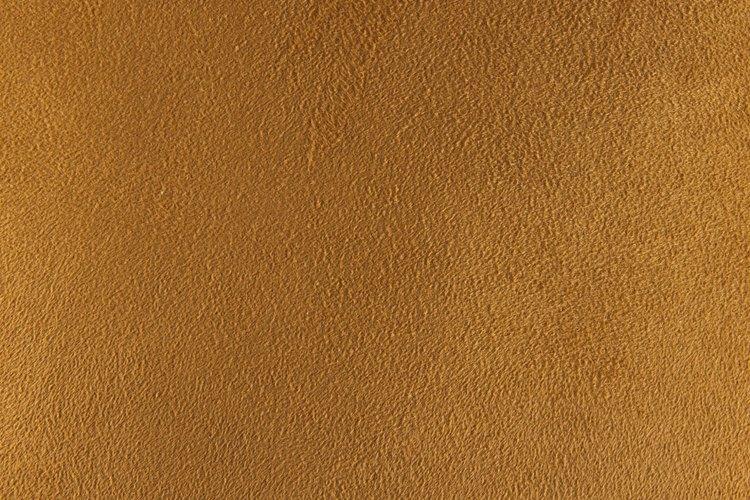 Las carteras Gucci auténticas estan siempre hechas de piel, gamuza o tela.