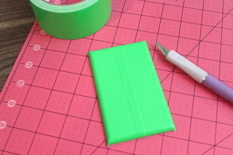 Cubre la placa con cinta adhesiva verde.