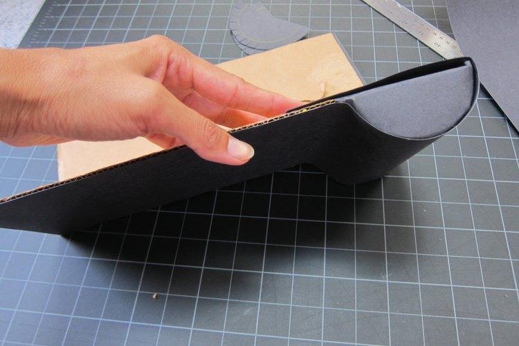 Añade un papel negro a los bultos.