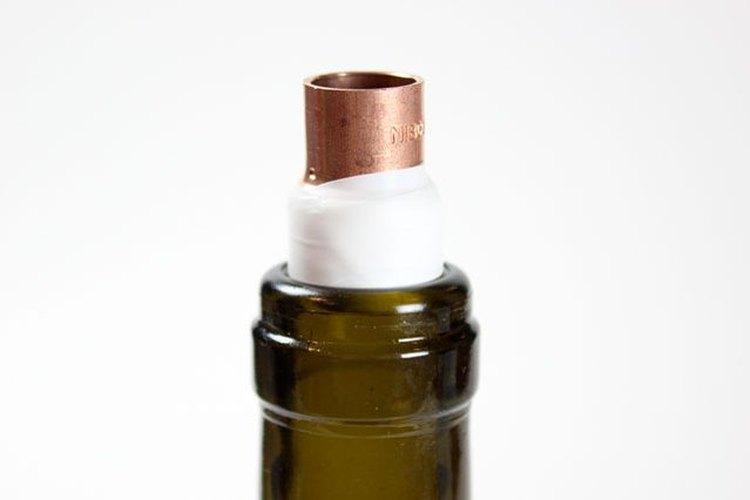 Prueba el acoplamiento en la botella.