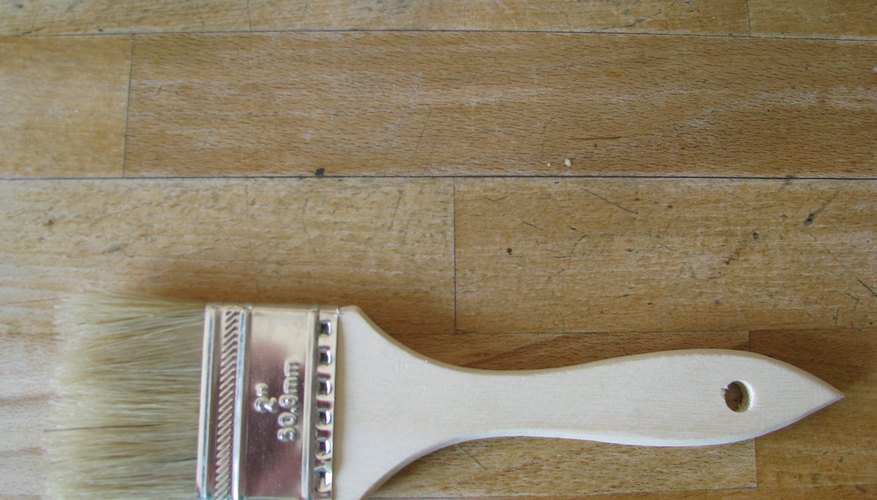 A paint brush can be used to cover wood stain.