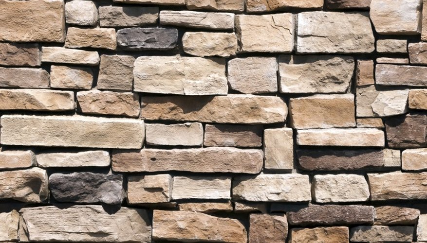Water is the best cleaner for stone walls.