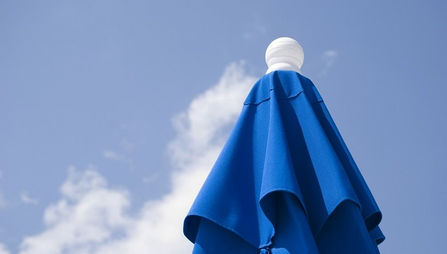 Protect yourself from the sun with a garden umbrella.