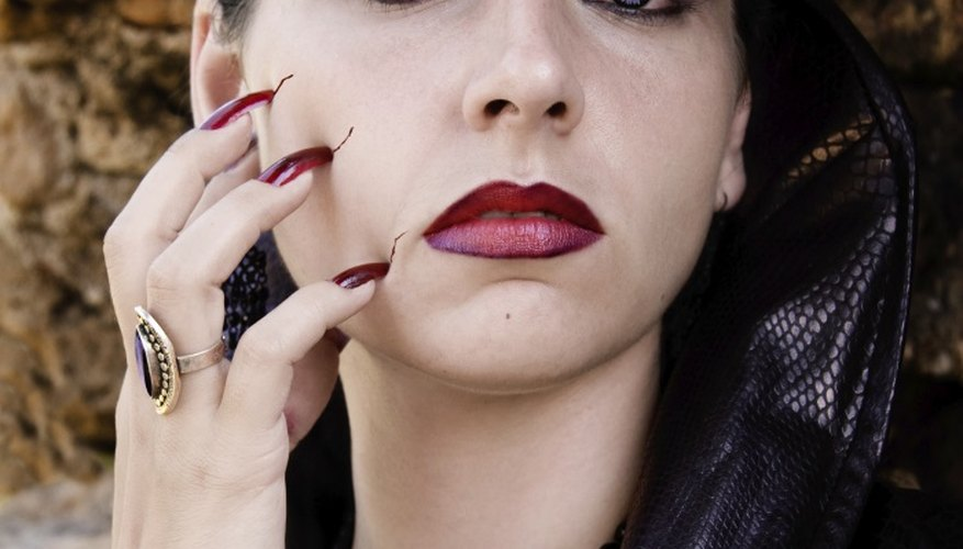 Make realistic looking scratch marks on your face using paint instead of fingernails.
