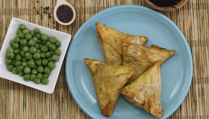 Fold a perfect samosa shape and then seal the edges.