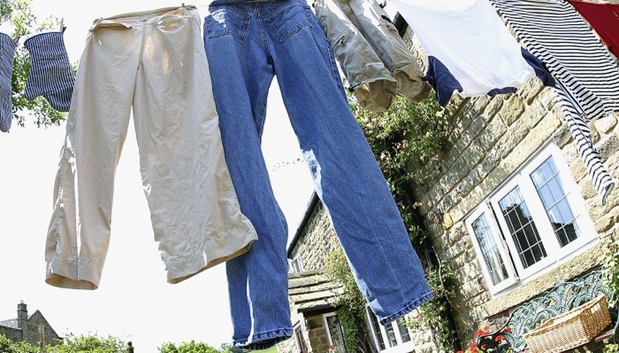 Hang dry-cleaned clothes on an outside washing line to remove musty odours.
