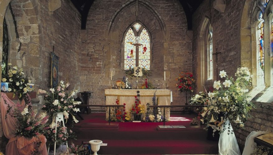 Altar flowers help draw the focus to the front of the church.