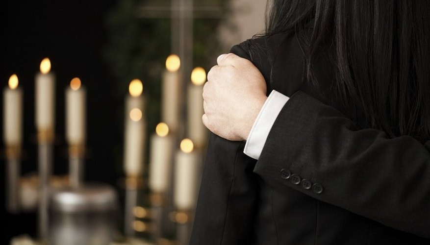 Black armbands are often worn by groups to show a solidarity of respect for the deceased.