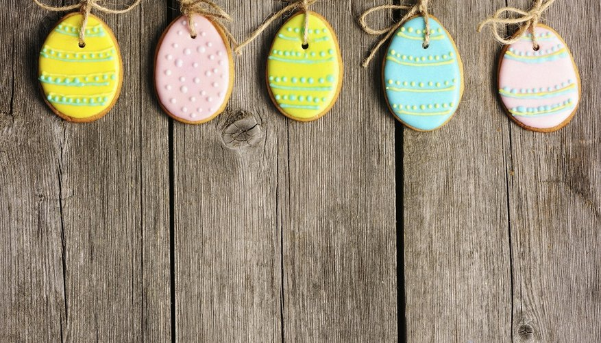 Painting eggs helps develop children's artistic abilities and fine motor skills.