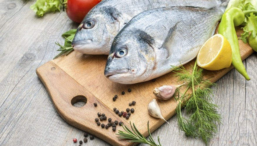 Adding lemons or herbs to fish can cover up a strong fishy taste.