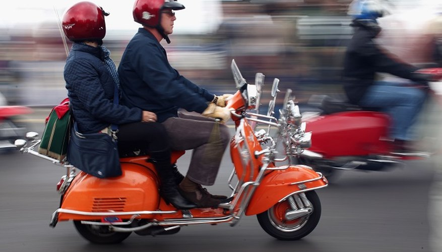 Adjust the drum brakes on your classic scooter.