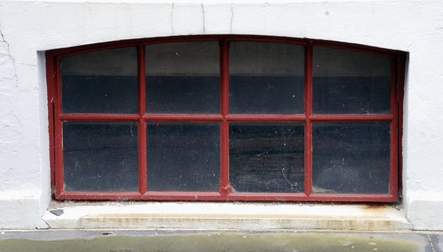 Basement and cellar windows in older properties are often set back into a window well.