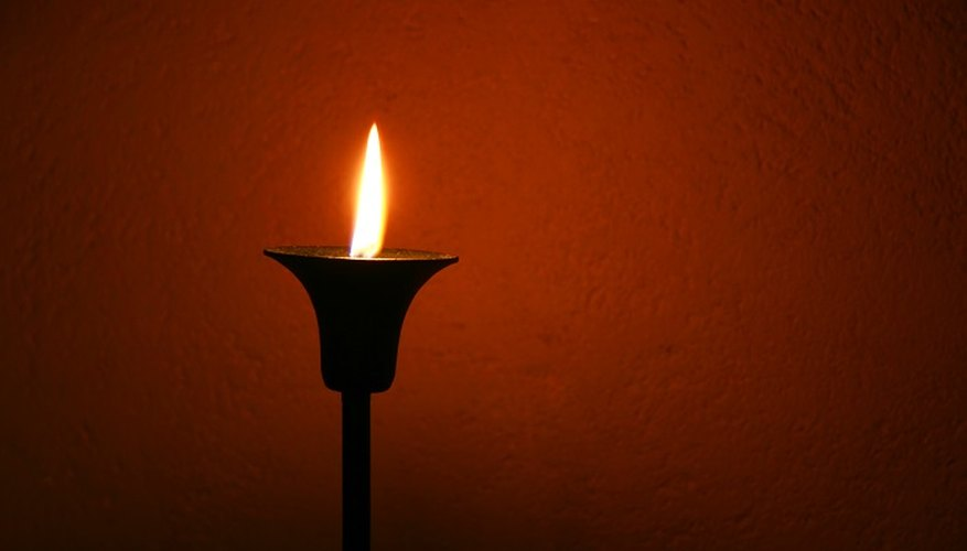 Remove candle soot from walls with soapy water.