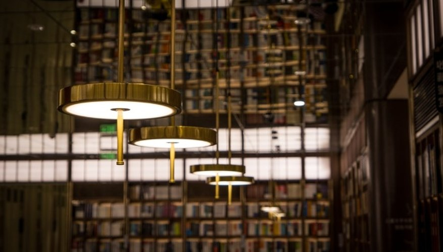 White pendant lamp turned on inside library.jpg