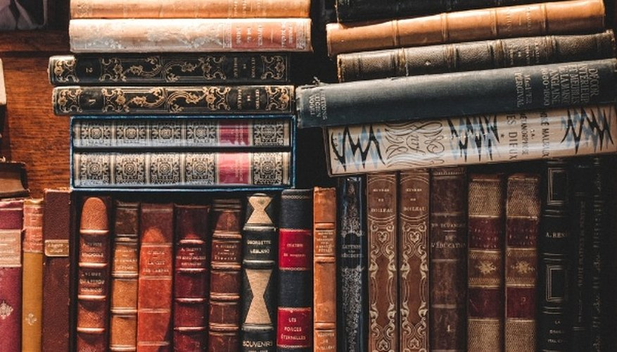 Brown and black books on shelf.jpg