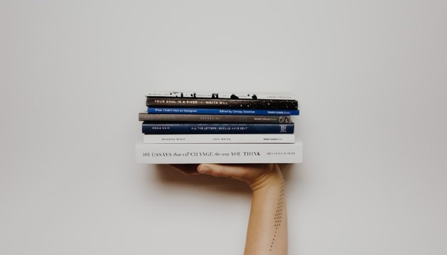 Person holding pile of books.jpg