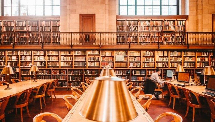 Man sitting on chair inside library.jpg