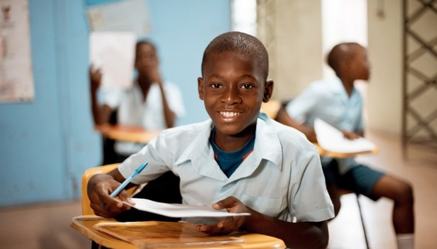 Boy holding white paper.jpg