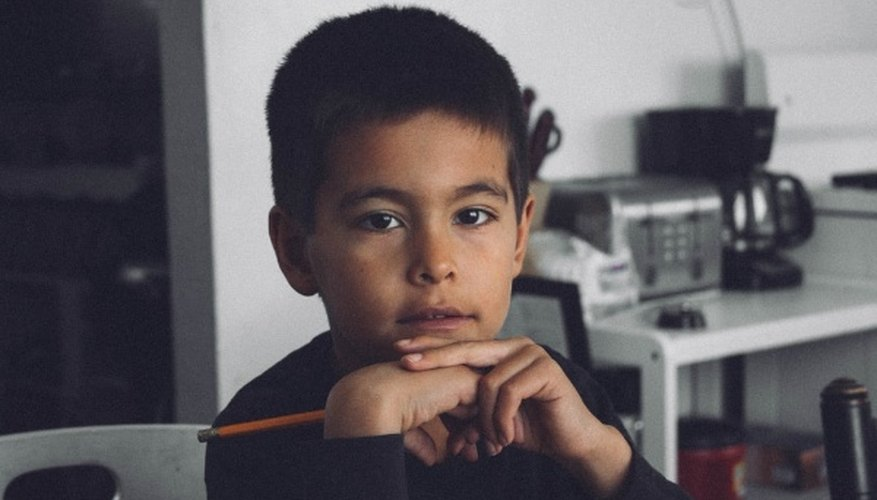 Boy with black long-sleeved shirt holding pencil inside room.jpg