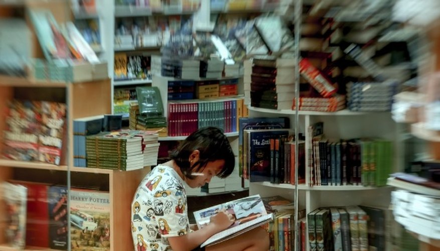 Girl writing in book store.jpg