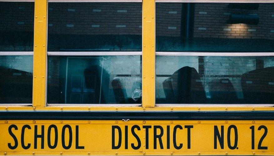 Yellow school bus in front of building.jpg