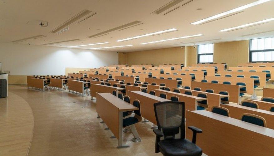 Black swivel chair beside rectangular brown wooden desk.jpg
