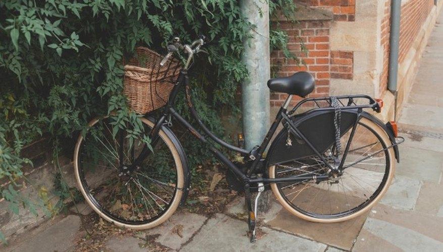 Parked black commuter bike near building.jpg
