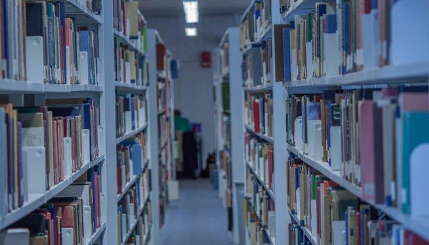 Assorted books on shelf inside building.jpg