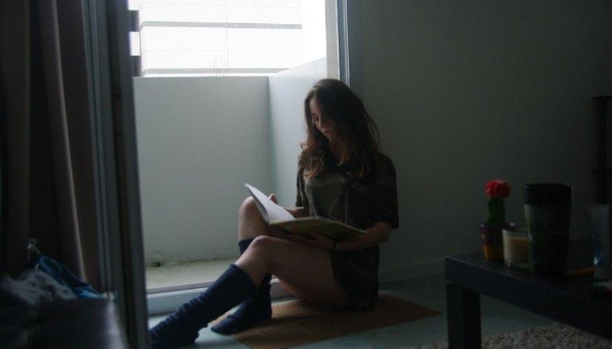 Sitting woman leaning on an open door.jpg