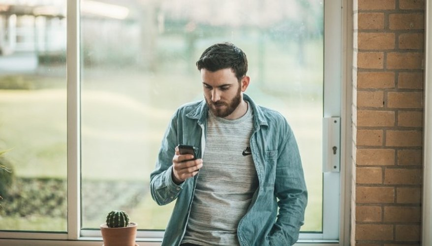 Man using his smartphone.jpg