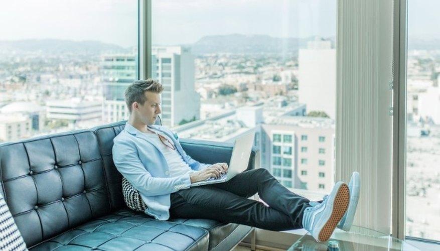 Man sitting on sofa while using laptop.jpg