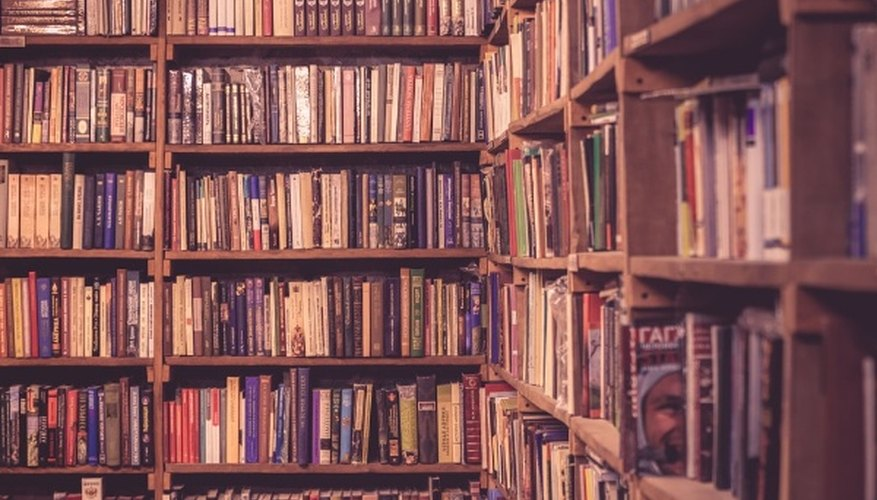 Brown wooden bookcases filled with books.jpg