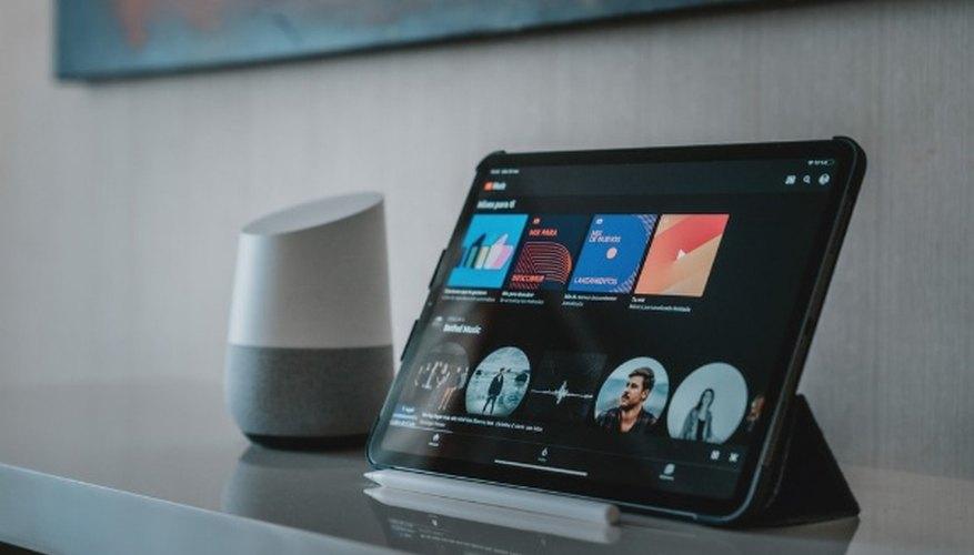 Black tablet computer on white table.jpg