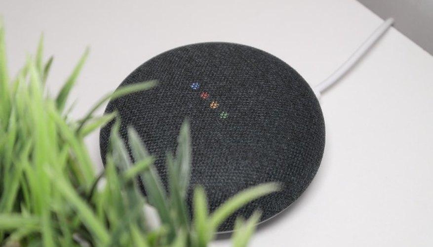 Black round portable speaker on white table.jpg