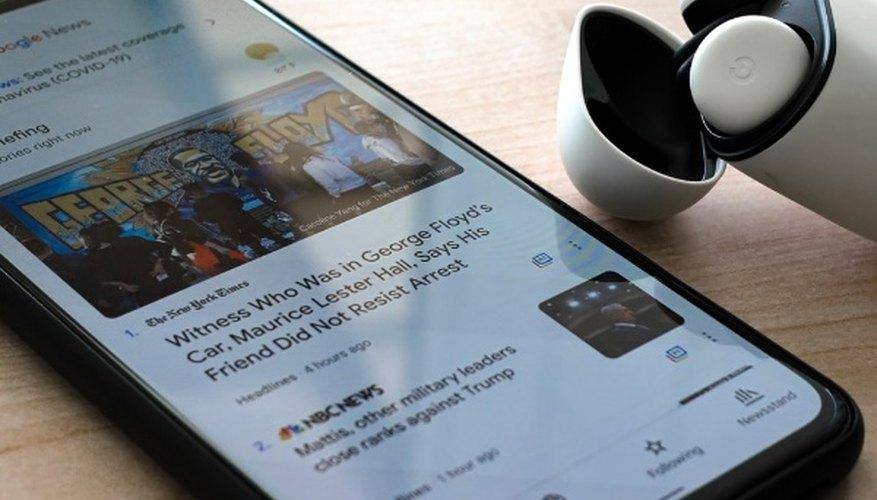 Black iphone 7 on brown wooden table.jpg