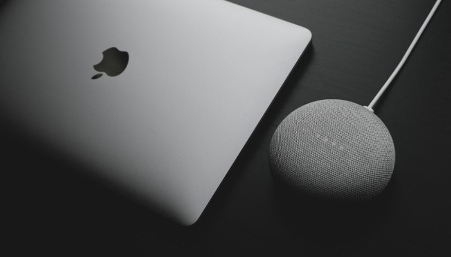 Silver macbook on black table.jpg