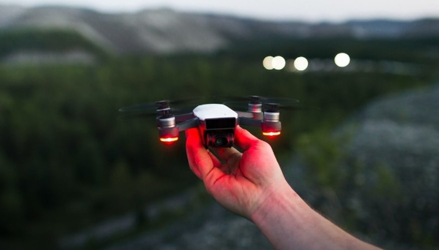 Person holding black and red quadcopter.jpg