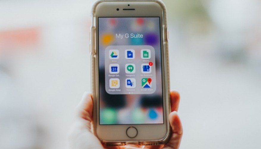 Person holding silver iphone 6.jpg