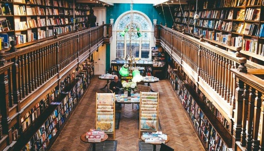 Books arranged on shelves inside library.jpg
