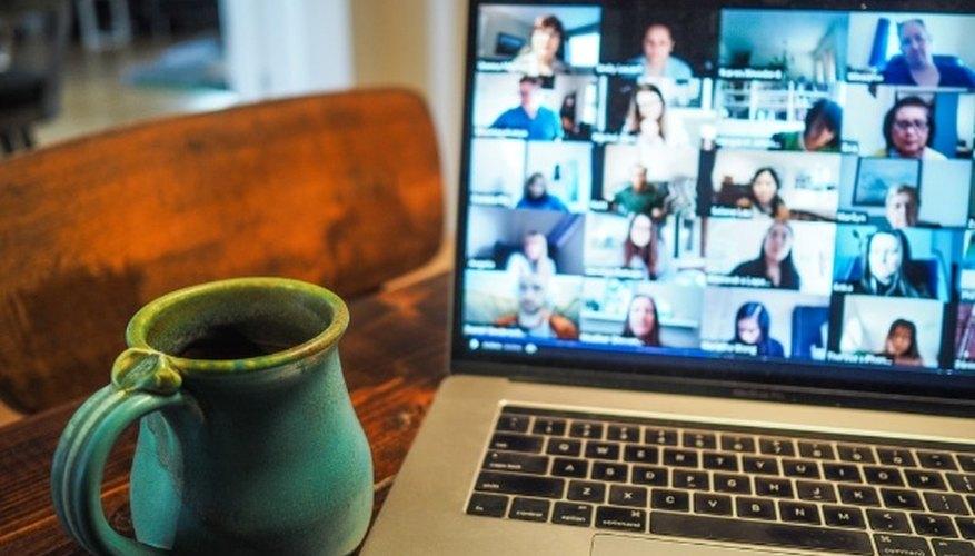 Macbook pro displaying group of people.jpg