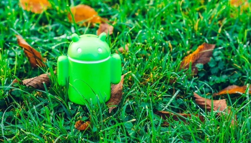 Green android robot toy on grass.jpg