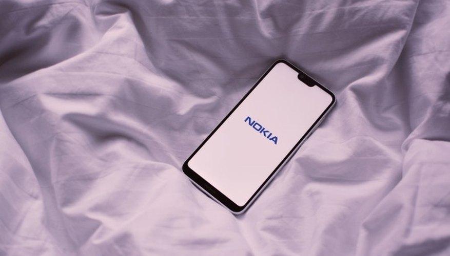 Black nokia phone on white textile.jpg
