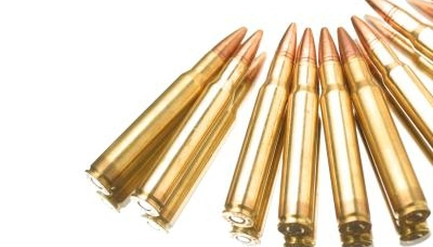 The primers are visible on these rifle cartridges
