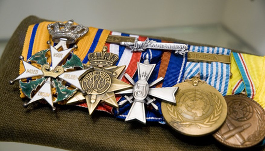 Full-sized medals should be mounted on a fixed bar and displayed in order of prestige.